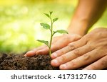 hands growing and nurturing... | Shutterstock . vector #417312760