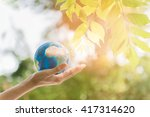 holding earth planet in the...   Shutterstock . vector #417314620