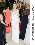 Small photo of Monday May 2, 2016 - New York, New York - Elle Fanning attends the Metropolitan Museum of Art Costume Institute Gala, Manus x Machina: Fashion in an Age of Technology