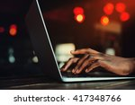 black man's hands typing on... | Shutterstock . vector #417348766