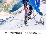 mountaineer reaches the top of... | Shutterstock . vector #417355780