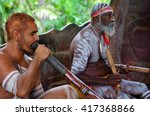 Small photo of Australian Aboriginal men play Aboriginal music on didgeridoo and wooden instrument during Aboriginal culture show in Queensland, Australia.