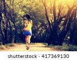 young fitness woman runner... | Shutterstock . vector #417369130