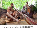 Small photo of Australian Aboriginal men play Aboriginal music on didgeridoo and wooden instrument during Aboriginal culture show in Queensland, Australia.