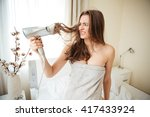 unhappy woman in towel holding... | Shutterstock . vector #417433924