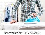 closeup of woman ironing... | Shutterstock . vector #417436483