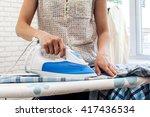 Closeup Of Woman Ironing...
