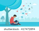 young man sitting in the park... | Shutterstock . vector #417472894
