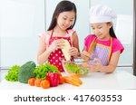 asian kids enjoyed cooking | Shutterstock . vector #417603553