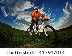 biker in orange jersey riding... | Shutterstock . vector #417647014