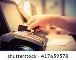 moment of payment with a credit ... | Shutterstock . vector #417659578