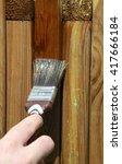 woman painting wooden furniture ... | Shutterstock . vector #417666184