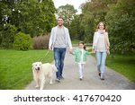 Stock photo family pet domestic animal and people concept happy family with labrador retriever dog walking 417670420