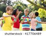 playful children blowing... | Shutterstock . vector #417706489