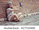 girl sitting on the floor with... | Shutterstock . vector #417723400