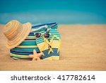flip flops and bag on sandy... | Shutterstock . vector #417782614