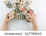 playing with block toys | Shutterstock . vector #417789010