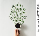 coffee cup with leaves. flat...   Shutterstock . vector #417791386