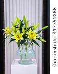 Yellow White Lilies In Glass...