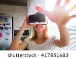 woman wearing virtual reality... | Shutterstock . vector #417851683