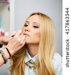 close up of a make up artist... | Shutterstock . vector #417863344