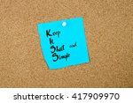 Small photo of Business Acronym KISS as Keep It Short and Simple written on blue paper note pinned on cork board with white thumbtack, copy space available