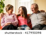Portrait Of Grandparents With...