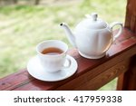 cup of black tea and kettle on... | Shutterstock . vector #417959338
