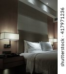 Stock photo night scene in hotel room nightstand with lamp 417971236