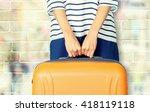 woman holds orange suitcase. | Shutterstock . vector #418119118