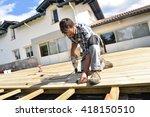 carpenter building wooden deck  | Shutterstock . vector #418150510