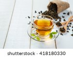 cup of tea and leaves tea on... | Shutterstock . vector #418180330