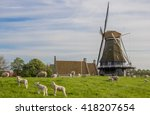 Windmill And Sheep On A Dike I...