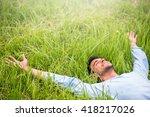 happy beautiful man lying on...   Shutterstock . vector #418217026