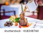 rack of lamb with vegetables... | Shutterstock . vector #418248760