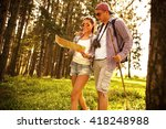 couple hiking. using map to get ... | Shutterstock . vector #418248988