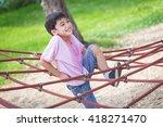 Little Asian Boy Climbing Rope...