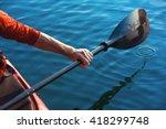 kayak man's hand holding a red... | Shutterstock . vector #418299748