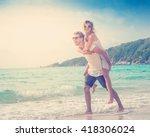beautiful young couple walking... | Shutterstock . vector #418306024