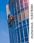 men cleaning glass building.... | Shutterstock . vector #418378084