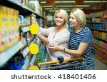 two smiling female customers... | Shutterstock . vector #418401406