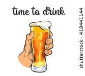 hand holding a full glass of...   Shutterstock .eps vector #418441144
