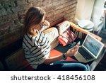 attractive female freelancer... | Shutterstock . vector #418456108