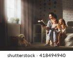 family reading bedtime. pretty... | Shutterstock . vector #418494940