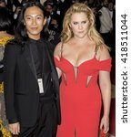 Small photo of New York City, USA - May 2, 2016: Alexander Wang and Amy Schumer attends the Manus x Machina Fashion in an Age of Technology Costume Institute Gala at the Metropolitan Museum of Art