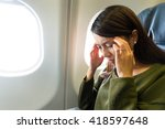 Small photo of Woman in plane suffer from airsick with stress headache