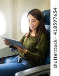 woman using tablet on board the ... | Shutterstock . vector #418597654