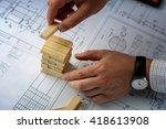 man architect builds model