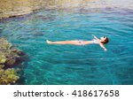 young woman floating on the... | Shutterstock . vector #418617658