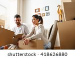 young couple unpacking... | Shutterstock . vector #418626880